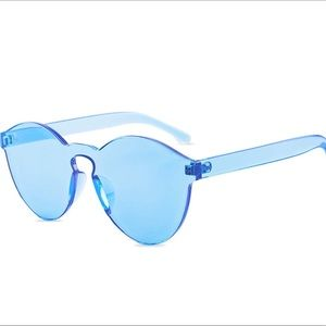 Ice blue colored transparent sunglasses - tinted